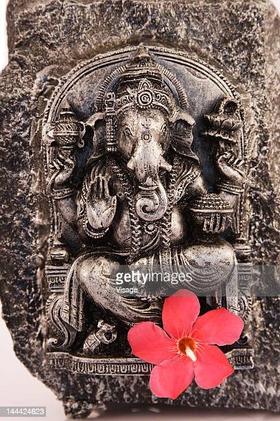 lord ganesh engraved on a stone, close-up - hindu god stock photos and pictures