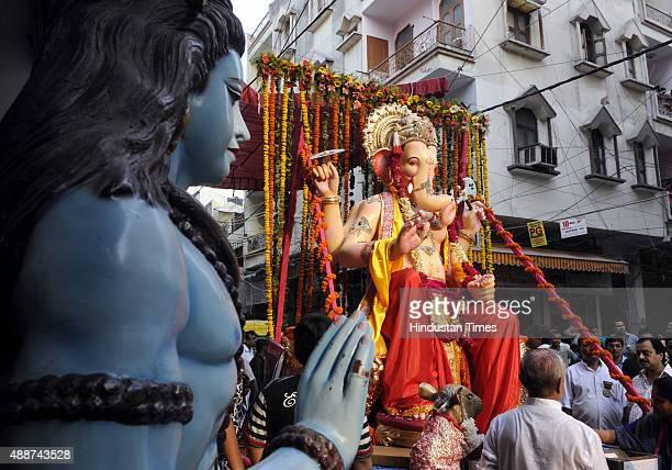 Lord Ganesha's idol during the procession before the installation at Laxmi Nagar on September 17, 2015 in New Delhi, India. Hindu festival Ganesha...