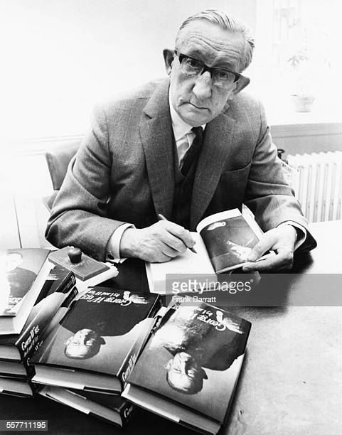Lord George Wigg, Chairman of the Betting Levy Board, signing copies of his autobiography at a press conference, London, May 11th 1972.