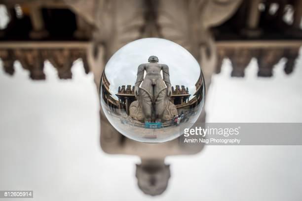 lord gommateshwara statue, shravanabelagola, india captured inside a crystal ball - digambara stock-fotos und bilder