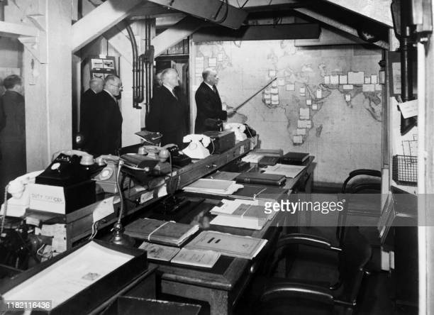 Lord Hastings Ismay who was military advisor of the cabinet of war shows the map of the operations still in place in the room of cards in March 1948...