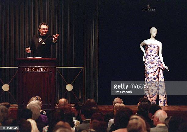 Lord Hindlip, Chairman Of Christie's International, Taking Bids For Lot 8 [a Dress Designed By Fashion Designer Catherine Walker And Worn By The...