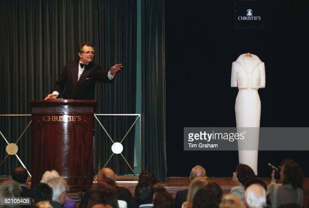 Lord Hindlip, Chairman Of Christie's International, Taking Bids For Lot 78 [a Beaded Dress And Bolero Jacket Designed By Fashion Designer Catherine...