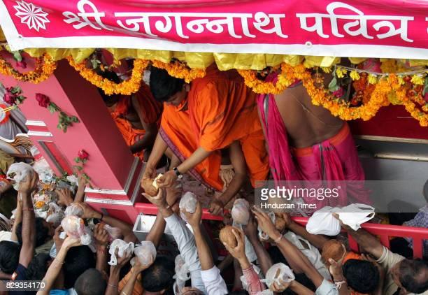 Lord Jagannath Rath Yatra Devotees offer coconuts to lord Jagannath's charriot near Jagannath Mandir at Saki Naka on Monday