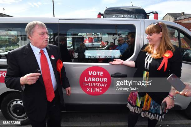Lord John Prescott and Shadow Secretary of State for Education Angela Rayner stand beside Lord Prescott's minibus displaying a sign reading 'Prescott...