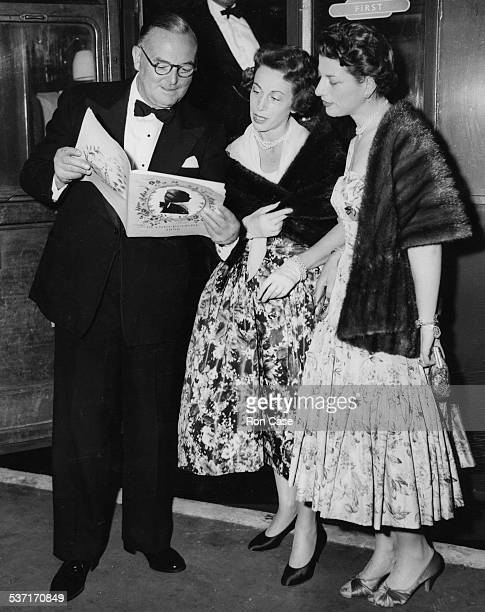 Lord John Wilmot Chairman of the Glyndebourne talking to Mrs George W Oak and Mrs David Ginsberg attending an opera at the Glyndebourne Sussex May...