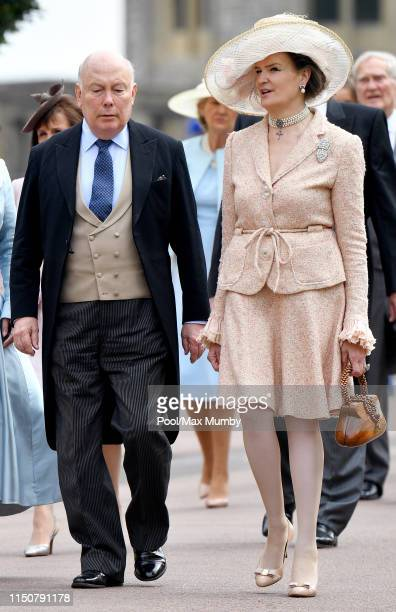 Lord Julian Fellowes and Emma Joy Kitchener attend the wedding of Lady Gabriella Windsor and Thomas Kingston at St George's Chapel on May 18, 2019 in...