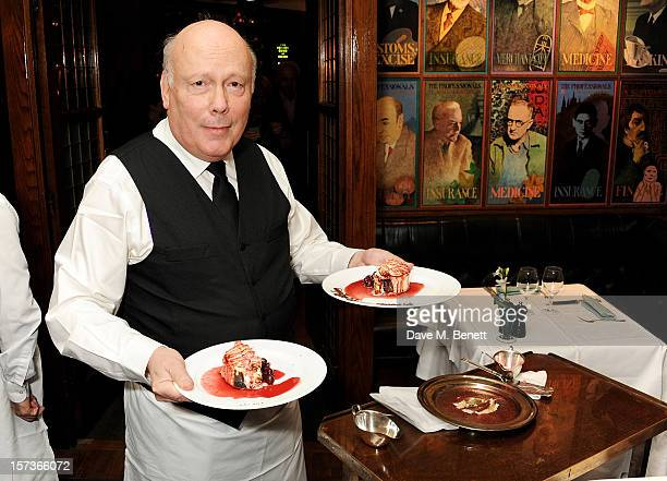 Lord Julian Fellowes working as a waiter attends One Night Only at The Ivy featuring 30 stage and screen actors working as staff during dinner at The...