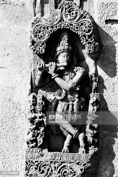 lord krishna playing flute sculpture, belur, karnataka, india, asia, 1985 - 1985 stock pictures, royalty-free photos & images