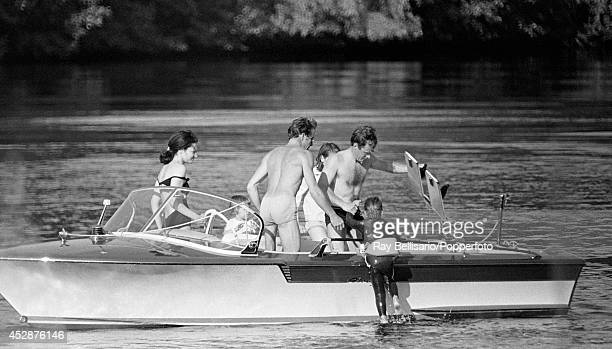 Lord Linley son of Princess Margaret and Lord Snowdon being helped out of the water by his father and instructor Tony Richardson British waterski...