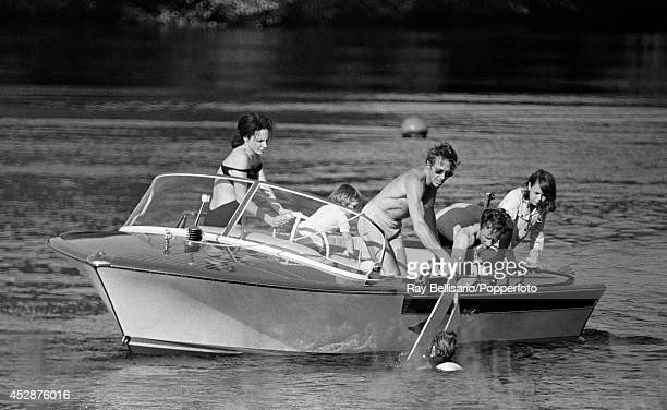 Lord Linley son of Princess Margaret and Lord Snowdon is handed waterskis by his father and instructor Tony Richardson British waterski champion at...