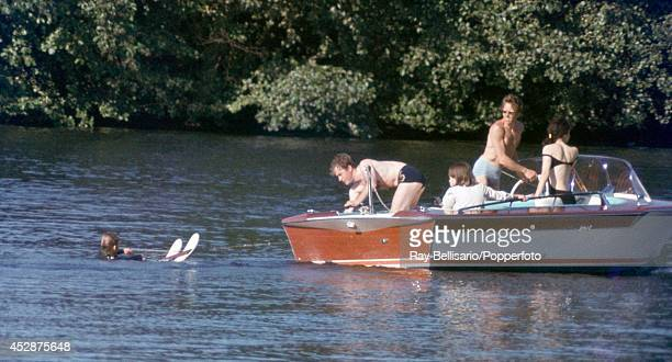 Lord Linley son of Princess Margaret and Lord Snowdon preparing to waterski whilst his father positions the boat at Sunninghill Park Windsor on 9th...