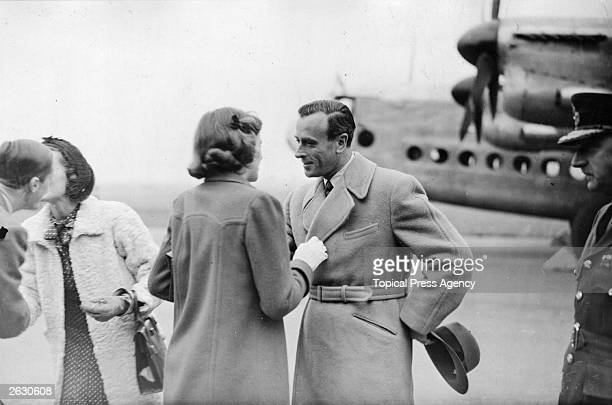 Lord Louis Mountbatten chatting to his daughter Patricia Mountbatten Lady Brabourne following his return from India