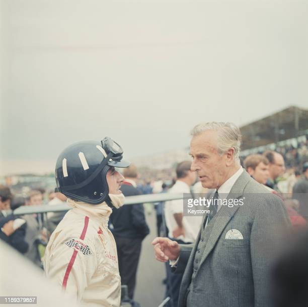 Lord Louis Mountbatten talks to British racing driver Graham Hill at Brands Hatch in England, 20th July 1968.