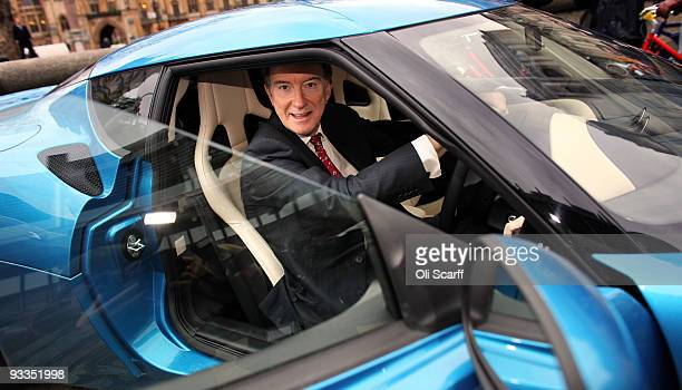 Lord Mandelson the Secretary of State for Business Innovation and Skills examines a new Lotus Evora car outside the Queen Elizabeth II Conference...