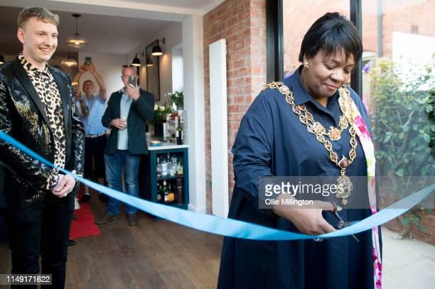 Lord Mayor of Birmingham Councillor Yvonne Mosquito cuts the tape as Lloyd Griffith sings the British national anthem at the official opening of Joe...