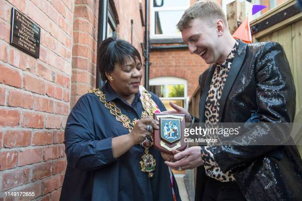Lord Mayor of Birmingham Councillor Yvonne Mosquito hands Joe Lycett some Birmingham themed gifts after unveiling a commemorative plaque at the...