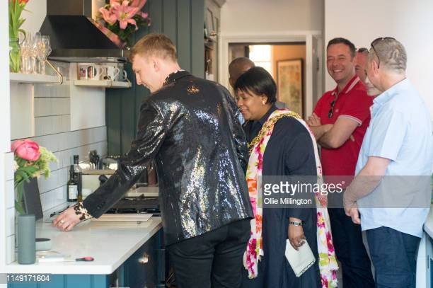 Lord Mayor of Birmingham Councillor Yvonne Mosquito is given a tour by Joe Lycett at the official opening of Joe Lycett's new kitchen extension at...