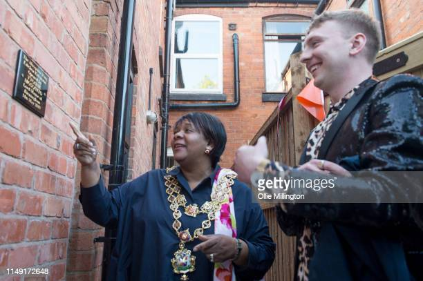 Lord Mayor of Birmingham Councillor Yvonne Mosquito unveils a commemorative plaque at the official opening of Joe Lycett's new kitchen extension...