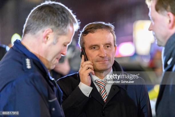 Lord Mayor of Dusseldorf Thomas Geisel is seen during police and emergency workers stand outside the main railway station following what police...