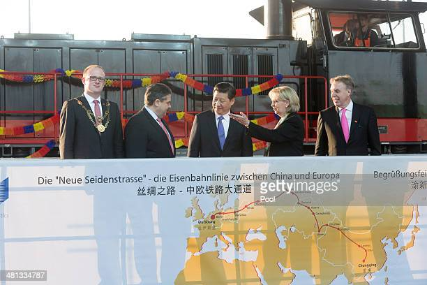 Lord Mayor of the city of Duisburg Soren Link Vice Chancellor and Economy and Energy Minister Sigmar Gabriel Chinese President Xi Jinping Prime...