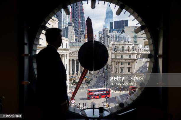 Lord Mayor of the City of London, William Russell enjoys the view of London's business centre during his visit to WeWork, a coworking and office...
