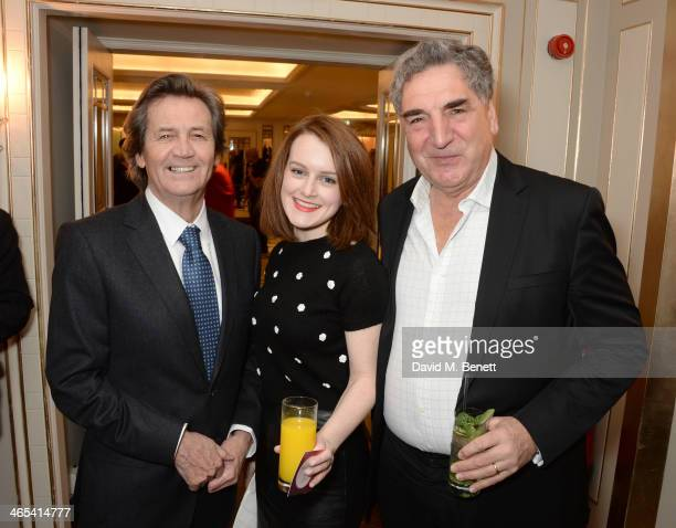 Lord Melvyn Bragg Sophie McShera and Jim Carter attend a drinks reception at the South Bank Sky Arts awards at the Dorchester Hotel on January 27...
