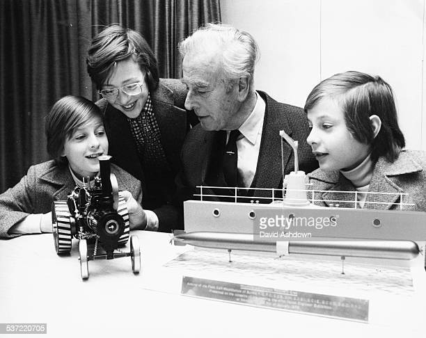Lord Mountbatten and his grandsons Nicholas Knatchbull Ashley Hicks and Timothy Knatchbull viewing an exhibition at the Engineering Exhibition in the...