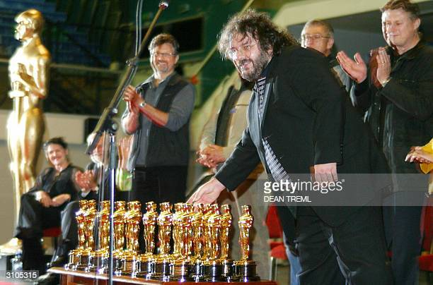 Lord of The Rings director Peter Jackson places his Best Director and Best Screenplay Oscars on a table with 20 others in front of the 3000 assembled...