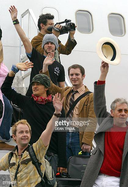 Lord of The Rings stars Andy Serkis Dominic Monaghan Elijah Wood Orlando Bloom Sir Ian McKellen and Billy Boyd wave at fans while boarding their Air...