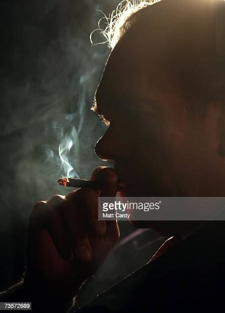 Lord Palmer smokes his cigar before the Lords and Commons Pipe and Cigar Smokers' Club annual luncheon on March 14 2007 in London England The...