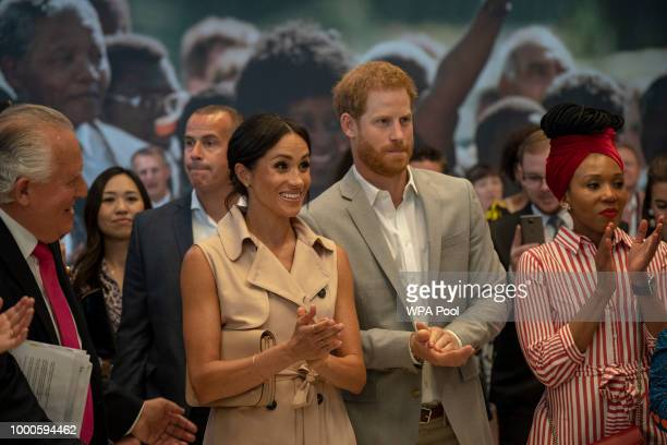 Lord Peter Hain Chair of The Nelson Mandela Centenary Committee accompanies Prince Harry Duke of Sussex Meghan Duchess of Sussex and Nelson Mandela's...