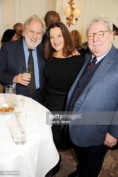 Lord Puttnam Barbara Broccoli and Sir Alan Parker attend a drinks reception awarding Sir Alan Parker the BAFTA Fellowship supported by Hackett at The...