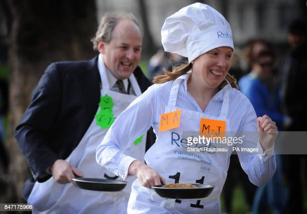 Lord Redesdale and Tracey Crouch MP take part in the annual Parliamentary Pancake Race in Westminster today raising money for the charity Rehab