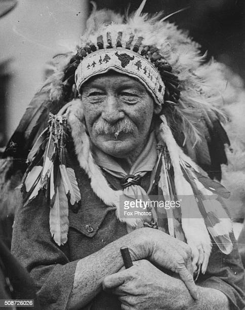 Lord Robert BadenPowell Chief of the Scouts wearing a Native American headdress at a jamboree circa 1935 Printed following his death in 1941