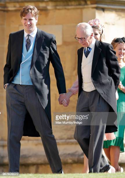 Lord Robert Fellowes and Alexander Fellowes attend the wedding of Prince Harry to Ms Meghan Markle at St George's Chapel Windsor Castle on May 19...