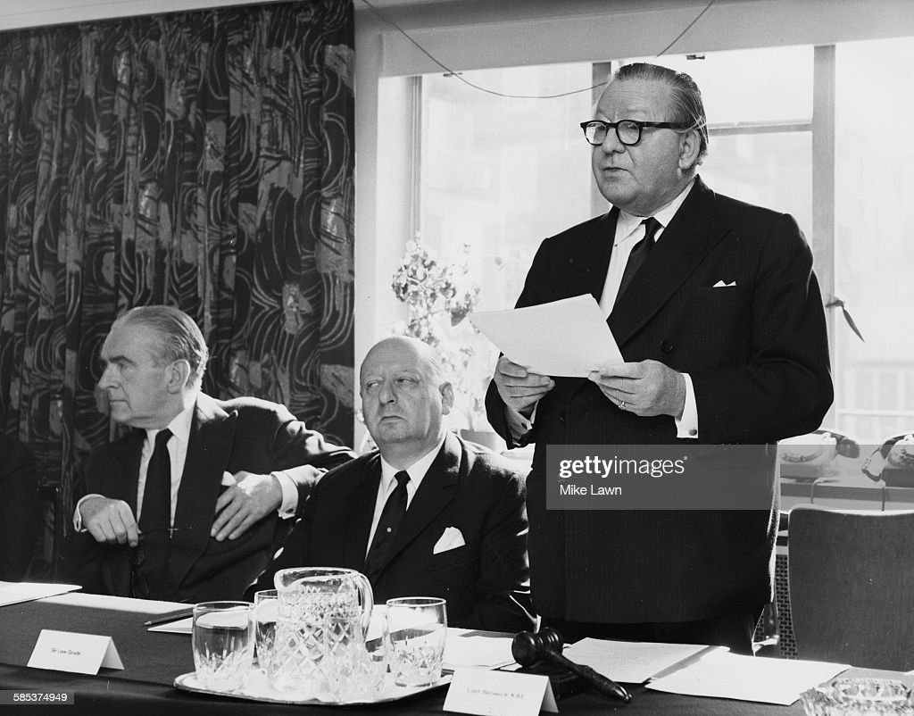 Lord Robert Renwick, Chairman of Associated Television Corporation, speaking the company's annual meeting, watched by Deputy Chairman Norman Collins (left) and Chief Executive Sir Lew Grade, in London, September 25th 1969.