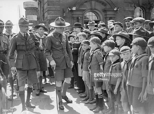 Lord Robert Stephenson Smyth BadenPowell founder of the Boy Scout Movement inspects a young Guard of Honour at Southampton