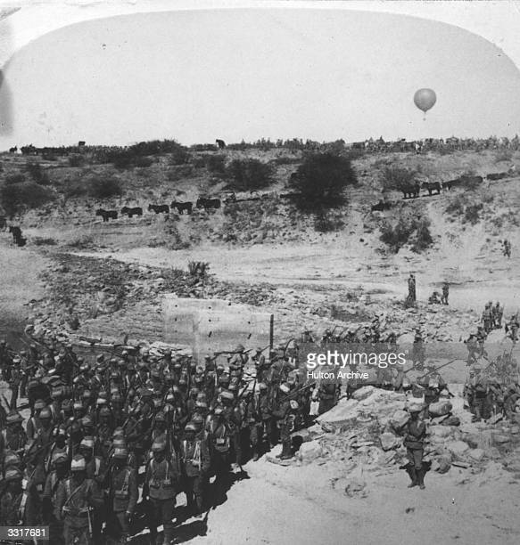 Lord Robert's Infantry crosses the Zand River as a balloon watches for the Boers