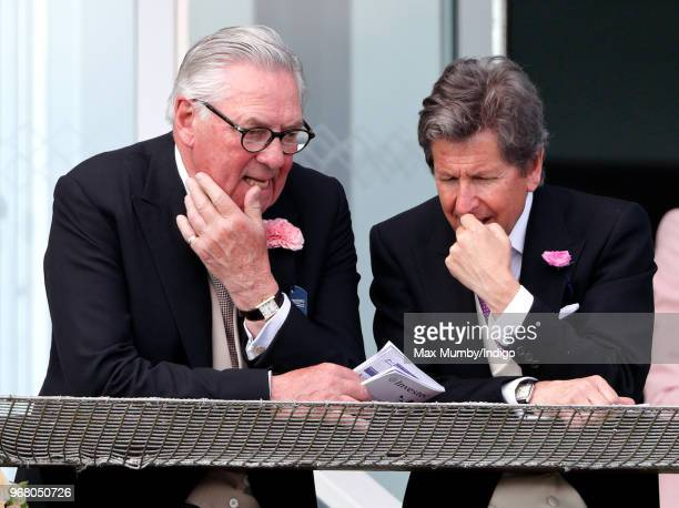 Lord Samuel Vestey and John Warren attend Derby Day of the Investec Derby Festival at Epsom Racecourse on June 2, 2018 in Epsom, England.
