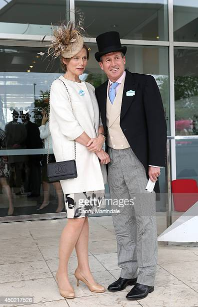Lord Sebastian Coe and Carole Annett attend Derby day at the Investec Derby Festival at Epsom Racecourse on June 7 2014 in Epsom England