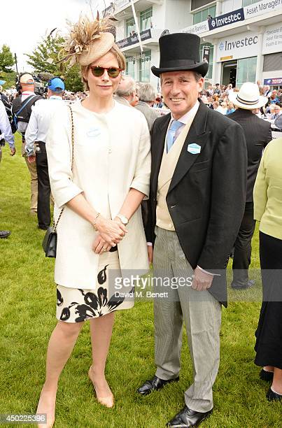 Lord Sebastian Coe and Carole Annett attend Derby Day at the Investec Derby Festival at Epsom Downs Racecourse on June 6 2014 in Epsom England