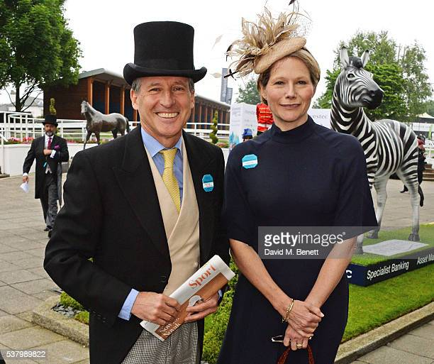 Lord Sebastian Coe and Carole Annett attend Derby Day during the Investec Derby Festival celebrating The Queen's 90th Birthday at Epsom Downs on June...