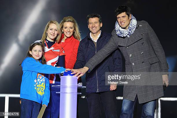 Lord Sebastian Coe Chairman of LOCOG presses the button with nine year old Niamh ClarkeWillis from HackneyDanielle Brown Gabby Logan and Vernon Kay...