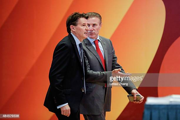 Lord Sebastian Coe walk with Sergey Bubka to the stage before during the 50th IAAF Congress at the China National Convention Centre CNCC on August 20...