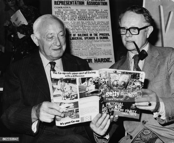 Lord Shinwell and Ron Hayward General Secretary of the Labour Party reading a booklet entitled 'The Pictorial History of the Labour Party 1900 1975'...