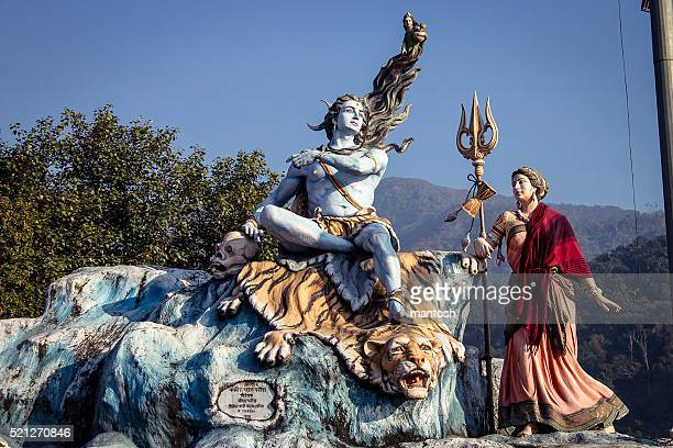 lord shiva and goddess parvati statue's in rishikesh. - shiva stock pictures, royalty-free photos & images