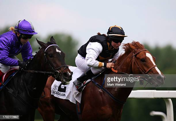 Lord Sholokhov ridden by Tamara Hofer leads the field in the Preis der Glucks Spirale during the Lotto Festival 2013 at Galopp Munich on June 9 2013...