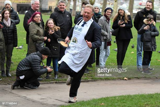 Lord St John of Bletso approaches the second corner in the annual Parliamentary Pancake Race in Victoria Tower Gardens on Shrove Tuesday on February...