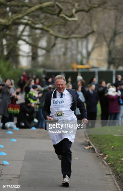 Lord St John of Bletso competes in the 21st Parliamentary Pancake Race on Shrove Tuesday, also known as Pancake Day or Fat Tuesday, in Victoria Tower...